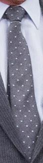 Grå slips med vita prickar